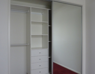Bank of shelves with 4 standard 140 deep drawers and half hang at 2050 off finished floor level